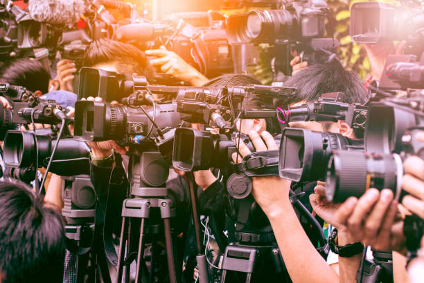 large number of press and media reporters in broadcasting event
